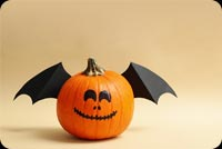 Pumpkins With Smile And Wings Background