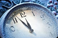 New Year Clock Powdered With Snow Background